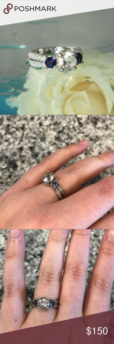 """Hermiker diamond and blue iolite sterling ring This ring is a size 6.5. It has a 1.68 carat Herkimer diamond (from New York) in the center and two 0.20 carat blue iolite stones on either side. The double band has 0.32 carats of white topaz. The ring is sterling silver without any tarnish or major scratches. Herkimer diamonds are not true diamonds but are clear gemstones that are brilliant and sparkly. They are called """"attunement stones"""" as they bring peace and a sense of """"being."""" Barely worn…"""