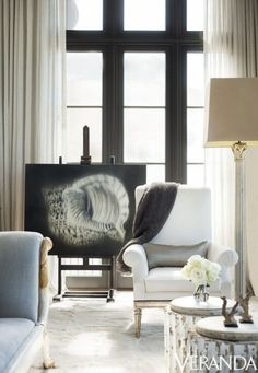 A palette of gray, white, silver, and gold creates an ethereal mood. LEFT: Chair in a Fabricut Cadence fabric, Gregorius Pineo; fluted tables, A. Tyner Antiques; art, Michael Dines.