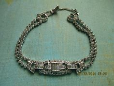 Exquisite Art deco period clear rhinestone bracelet $84.00 This would look lovely on a bride, or brides Mom at a wedding! A treasure from the past.   for Mom on mothers day as well.
