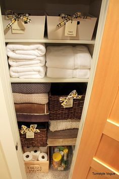 Love the ribbon pulls on the baskets in this linen closet - also has a big linky list at bottom!