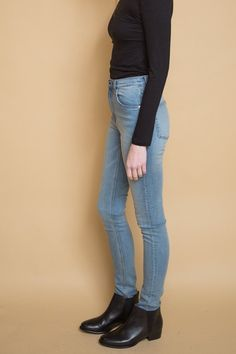 Cheap Monday Second Skin in Stonewash Blue wash. These jeans are high rise with a skinny fit with skinny legs. Five pocket jean with waist button and zipped ...