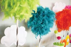 DIY Truffula Trees: feather boas + wooden dowels {Colorful Dr. Seuss' The Lorax Themed Birthday Party}