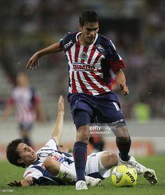 Xavier Baez of Chivas Guadalajara and Francisco Torres of Pachuca during their Closing Torneo Clausura 2009 on February 28, 2009 in Guadalajara, Mexico.