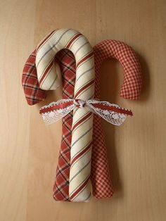 (make candy canes to go with ones i already have and tie together like this in sets) Christmas Bazaar Crafts, Christmas Crafts For Gifts, Christmas Sewing, Christmas Projects, Christmas Decorations, Christmas Ideas, Christmas Makes, Noel Christmas, Primitive Christmas