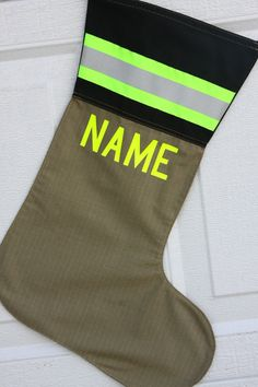 Firefighter stocking looks like turnout bunker gear with custom name and reflective stripe. Great gift for a firefighter or ems.. $25.00, via Etsy.