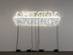 """Artwork: In """"Double America,"""" a work in neon and paint from 2012, 2 neons are put together. Some letters are flipped, but not all are backwards. The artist references Caspar David Friedrich's """"Rückenfigur"""" paintings, or """"back-figure"""" paintings. In these German romantic works, figures in the landscape have their backs to the viewer, contemplating an idealist landscape. How might Ligon's """"Double America"""" question the landscape of a country? #blackhistorymonth African American Artist, American Artists, Caspar David Friedrich, Romantic Words, National Gallery Of Art, Black History Month, Art Object, Figure Painting, Appreciation"""