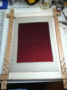 dressed slate frame All dressed up and ready to embroider on. It really has a nice tension. Note the direction of the holes on each side going in opposite directions. Holes on left rise to the left, holes on right rise to the right. This is important.