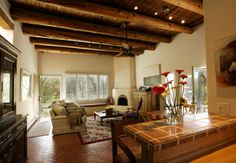 The grandness  of the interiors of the typical southwest home gives you a feeling of vastness as big as the wide open spaces of the land. Love the great rooms with their beams exposed against stark stucco walls.