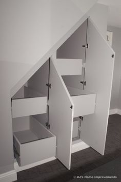 under stair storage - I think this would be more useable storage than the closet that's currently under my stairs!