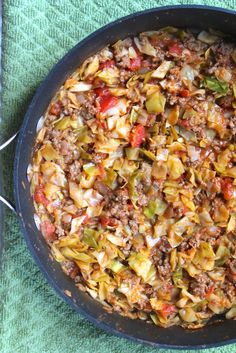 Amish One Pan Ground Beef and Cabbage Skillet. A one-pan meal with ground beef, cabbage, tomatoes and more - budget-friendly!