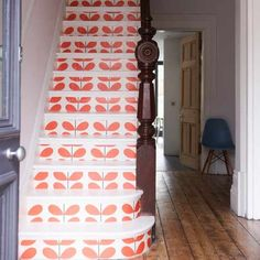 staircase with orla kiely wallpaper - I like the idea of wallpaper in nontraditional places, like stairs, or dresser drawers, or inside a cabinet.