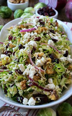 Shaved Brussels Sprout Salad with Walnuts, Cranberries and Goat Cheese - A Family Feast® Shaved Brussels Sprout Salad - This easy salad is full of fantastic flavor! A delicious, light meal or side to grilled meats. Vegetarian Recipes, Cooking Recipes, Healthy Recipes, Vegetarian Salad, Winter Salad Recipes, Christmas Salad Recipes, Arugula Salad Recipes, Chopped Salad Recipes, Shaved Brussel Sprouts
