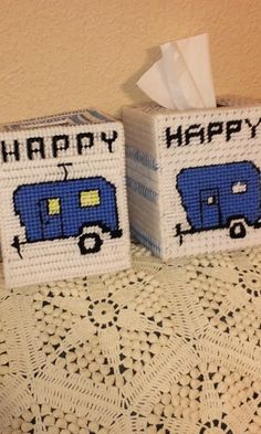 Two different plastic canvas Happy Camper boxes.