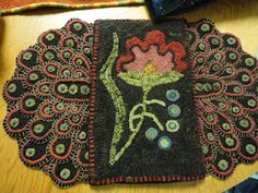 floral hooked rug with embellished penny tongues