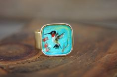 Hand Painted Hummingbird Ring Original Art in Antique Gold Adjustable Band - Ruby by FlowerleafStudio on Etsy https://www.etsy.com/listing/221369449/hand-painted-hummingbird-ring-original