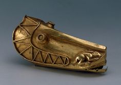 Terminal Shaped Like a Horse's Head  Gold; forged, soldered, stamped, repousse. L. 10 cm  Scythian culture. Late 6th - early 5th century BC  Ulsky Aul Barrow No. 2, Adygeya Republic (formerly Kuban Region), the Village of Ulyap  Russia  State Hermitage Museum