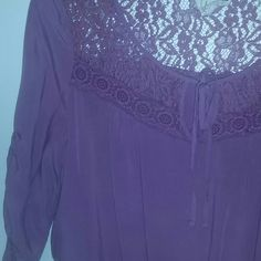 Purple peasant blouse It's a very purple - pink in person. Size large but fits more like a medium (why I put medium as the size). Floral lace on the chest, top of the back, and bottom of shirt. Tie front. I've never worn it, just isn't really my taste. Tops Blouses