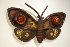 Moth sculpture by Michelle Stitzlein.  11 feet wide, made from found objects.