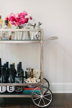 Always thought a bar cart or bar area was just so chic in a home. This one really takes the cake - 10 Tips for Styling a Bar Cart by Waiting on Martha | Camille Styles