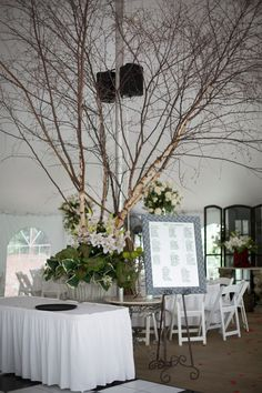 tree in center of reception. Hide those pillars, add directional light from below.