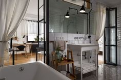 Dubbed the Apartment with Deer, this 1335 sq.ft. home is located in Kiev, Ukraine and was designed by Alena Yudina to embrace a white backdrop trimmed out with black and...