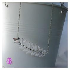 #Collar plateado con una #rama Elegante y delicado