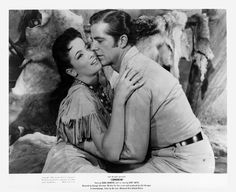 COMANCHE (1956) - Dana Andrews (pictured) - Linda Cristal (pictured) - Kent Smith - Henry Brandon - Stacy Harris - Directed by George Sherman - United Artists - Publicity Still.