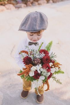 Let the ring bearer take the bouquet to the bride...VERY sweet photo!