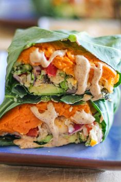 Collard Wraps with roasted mashed sweet potatoes, Thai cauliflower rice, avocado, and almond butter ginger dressing - a healthy plant-based vegan lunch recipeq