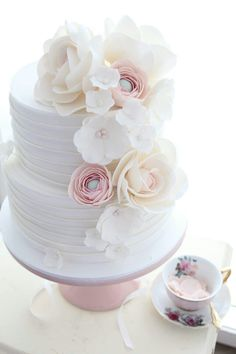Gorgeous white floral cake for her First Communion party. Such a great idea. Lovely First Communion Idea and Inspiration.