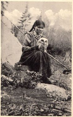 Indian woman and owl, Blind River, Ontario (c.1910).