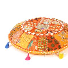 Khambadia Orange Round Decorative Seating Bohemian Floor Cushion Boho Pillow Cover with Shells - Browse Eyes of India for beautiful collection of Indian home decorative items and bohemian decor https://www.eyesofindia.com FREE SHIPPING WORLDWIDE for boho pillows, boho floor cushions, boho  pouf cushions, bohemian bedding, bohemian throws, bohemian rugs, bohemian wall hangings tapestries, knobs, hooks, handles, boho scarves, bohemian shawls, boho bags, bohemian purses, and more. #Bohemian…