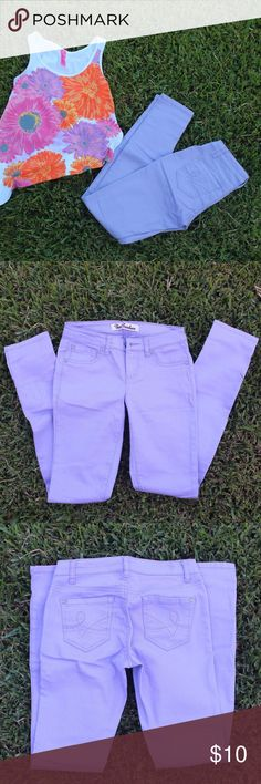 Skinny Jeans - Lavender Brand: True Freedom  Size: 1  Color: lavender/lilac Brand new and never used. They have been washed because they did obtain a storage smell to them and now smell like new. So no problems for you. I did purchase them with the intent to wear them and ended up not liking how they looked on me. I did take the tags off at the time. From the factory, the front pockets are sewn in - avoiding that bulkiness from the beginning. If you have any further questions regarding this…