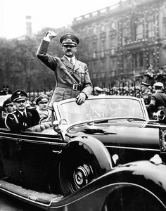 Adolph Hitler acknowledges cheers of the crowd as he left the Berlin Lustgarten, May 8, 1939