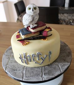 Harry Potter themed cake - little Hedwig with spellbooks, wand and scarf. https://facebook.com/karenscakesandart