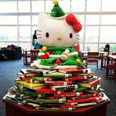 My library Christmas tree is made from two things I love very much - Hello Kitty AND books. #hellokitty #yalit