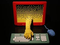 A Lego sculpture entitled 'Computer' is displayed at the Art of Brick Exhibition in London (Artist Nathan Sawaya stands with his sculpture 'Yellow' at the Art of Brick Exhibition)