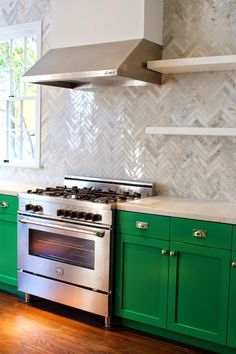 Lovely Kelly Green kitchen with Herringbone backsplash!