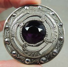 JEWELED SILVERED BRASS BUTTON WITH  FACETED AMETHYST GLASS STONE. GAY 90's.