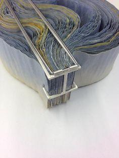 "rachel blair jewellery | Overwhelmed - reverse of ""overwhelmed"" ripple brooch - - white metal & ink stained paper"