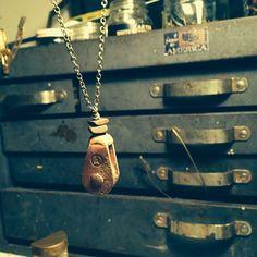 'A' pulley and bamboo. #rust #belt #americana #rustbeltamericana #vintage #junkyard #jewelry #pulley #mamboo #foundart
