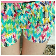 Multi Color Shorts Boutique style multi color shorts. Brand new with tags. Elastic waistband with tie at front. 100% rayon. Boutique Shorts