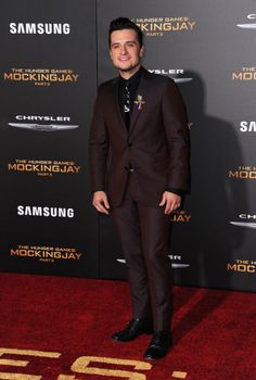 """Josh Hutcherson in a burgundy suit at the premiere of """"The Hunger Games: Mockingjay - Part 2″ in Los Angeles, California."""