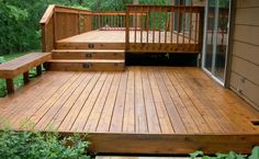 above ground pool with layered decks | Garage & Deck Construction | Supreme Siding & Roofing, Inc.