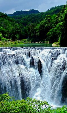 Shifen waterfall is a scenic waterfall located in Pingxi District, Taiwan, on the upper reaches of the Keelung River. The falls' total height is 20 meters and 40 meters in width, making it the broadest waterfall in Taiwan