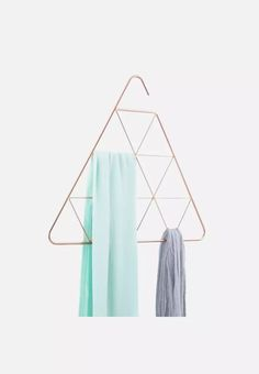 Umbra Pendant Triangle Scarf HangerHang and organize scarves and everyday accessories in this decorative hanger Geometric patterns inside allow for scarf storage Shape at the top is open to allow scarf holder to hook over-the-rod Scarf Display, Scarf Storage, Scarf Holder, Design3000, Color Cobre, Triangular Pattern, Home Storage Solutions, Storage Ideas, Quirky Decor