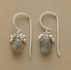 "WINTER SKY EARRINGS -- Naomi Herndon likens the sterling silver beads to clouds, the labradorites' opalescent hues to the colors of a winter sky at dusk. Handcrafted with French wires. 7/8""L."