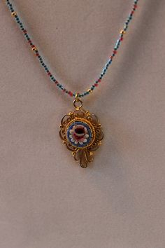 Vintage colorful 'Pietra dura' (micro-mosaic) flower and gold pendant on beaded necklace