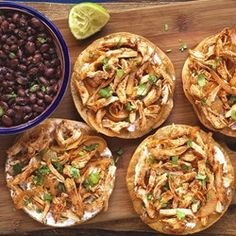 Nikki's notes:  Oh my goodness, so delicious!  Served like this:  first layer refried beans, next layer shredded lettuce, next chicken, next sour cream, next cojita cheese and sprinkled sliced natural black olives for saltiness and color interest.  Also grilled some shishito peppers.  Dee-licious! Chicken Tinga Tostados - Allrecipes.com