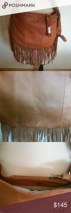 "Lucky brand Rickey leather crossbody fringe bag Brand new with tags. 13"" wide by 12"" height by 1 inch in diameter. Zipper closure, top in seam zipper pocket, 2 interior slip pockets & one back wall zipper pocket with suede trim. Cross body strap with 23"" drop & shoulder strap of 9.5"" drop. I am 5 feet 9 inches tall to show where it be full length. You can shorten it to suit you. The color states tobacco. Thank you. Lucky Brand Bags Crossbody Bags"